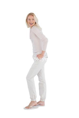 Happy woman with hands in pockets