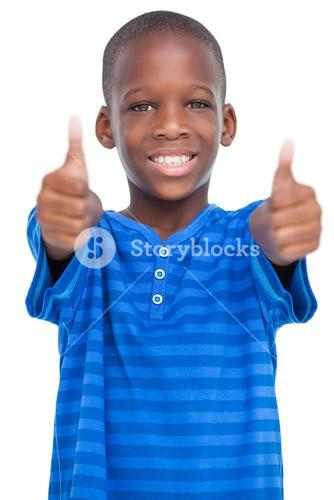 Smiling boy with thumbs up