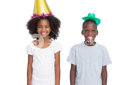 Kids wearing party hats