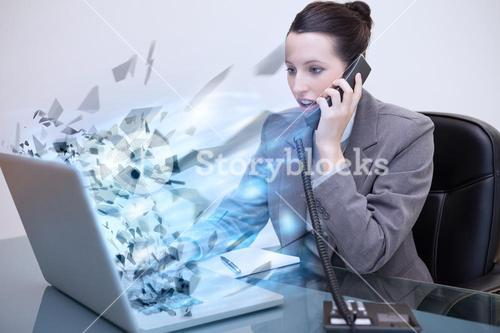 Laptop of a businesswoman exploding
