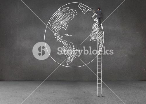 Businessman drawing earth with a chalk