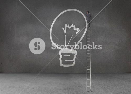 Businessman drawing a light bulb
