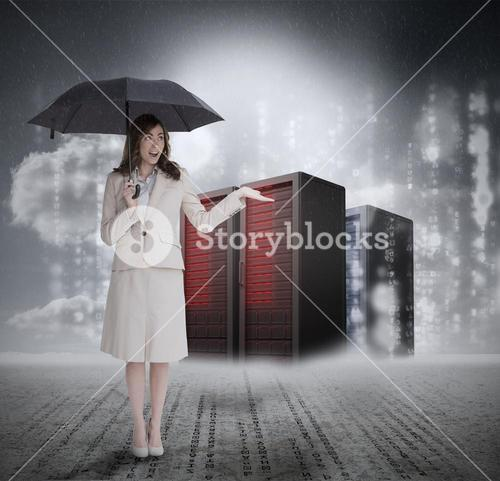 Businesswoman in front of servers holding umbrella