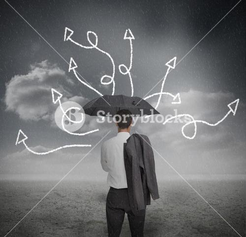 Businessman looking at jumble up arrows