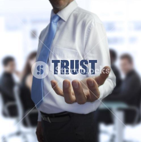 Sophisticated businessman holding the word trust