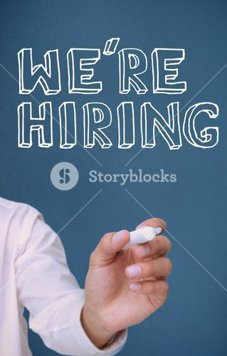 Hand holding a marker and writing were hiring