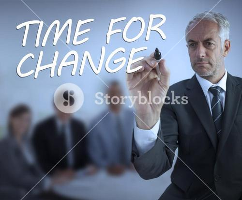 Stylish businessman writing time for change