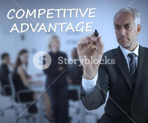 Sophisticated businessman writing competitive advantage