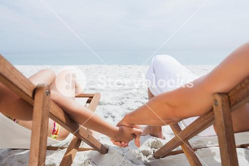 Couple resting on deck chairs