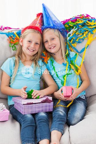 Cute twins unwrapping their birthday present