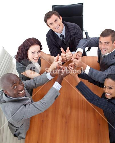 High view of happy business people with thumbs up