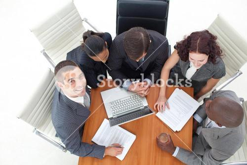 High angle of smiling businessman working with her team