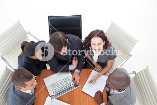 High angle of smiling businesswoman working with her team