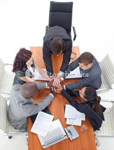 High angle of business team with hands together