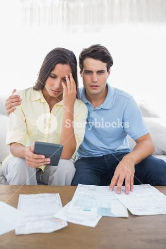 Stressed couple doing their accounts