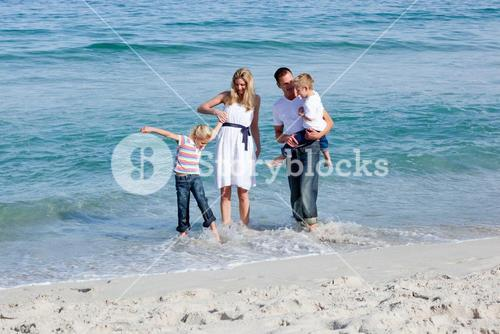 Lively family having fun at the beach