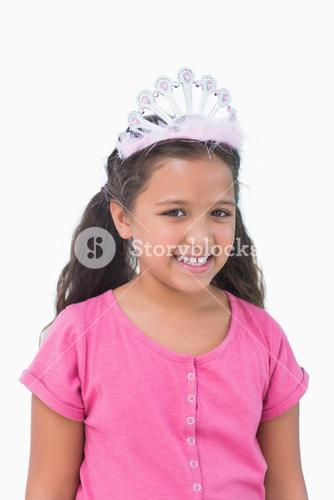 Smiling little girl wearing tiara for a party