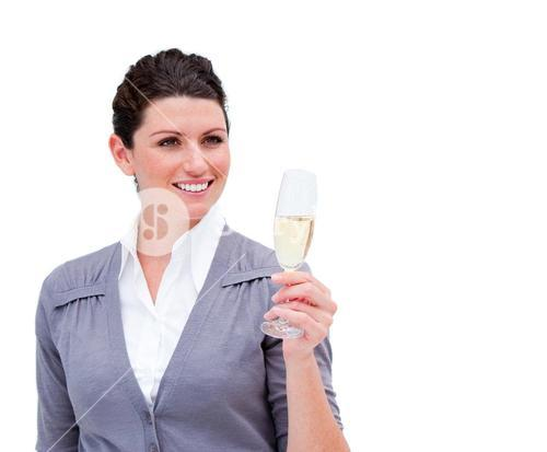 Portrait of a smiling businesswoman drinking Champagne
