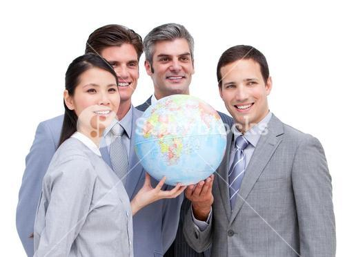 Confident business team looking at a terrestrial globe