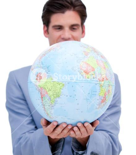 Portrait of an ambitious man holding a terrestrial globe