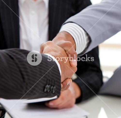 Close up of businessmen closing a deal