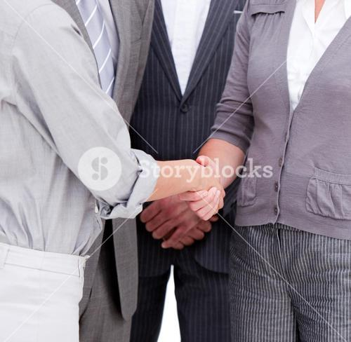 Close up of a positive Business team closing a deal