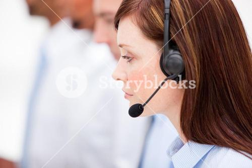 Close up of a female customer service agent and her team