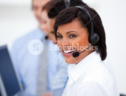 Close up of an customer service agent and her team