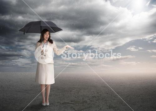 Sophisticated businesswoman holding an umbrella