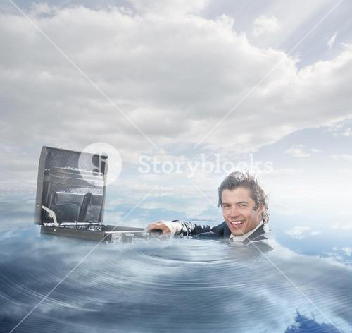 Businessman swimming in the water
