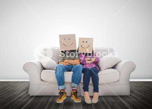 Funny couple wearing boxes on their head