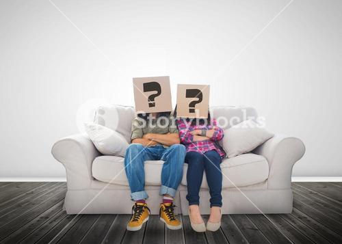Funny couple wearing boxes with question mark on their head