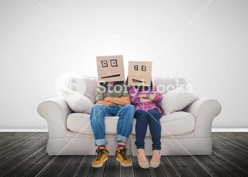 Couple wearing humorous boxes on their head