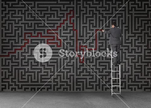 Businessman standing on a ladder and drawing a red line through black maze
