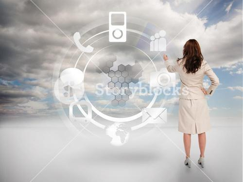 Businesswoman touching at a hologram with icons
