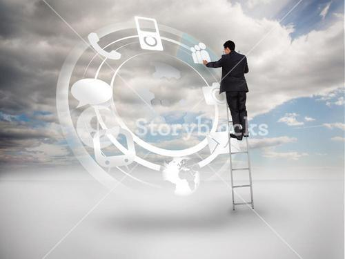 Businessman on a ladder touching at a hologram