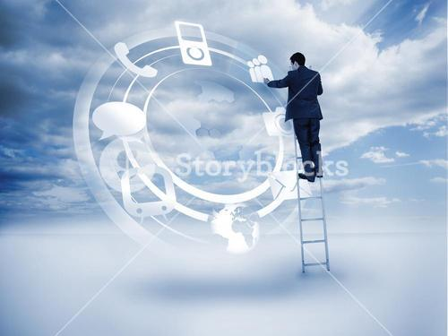 Businessman standing on a ladder and touching at a hologram