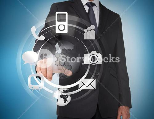 Businessman selecting icons on a hologram