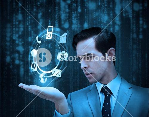 Businessman holding a hologram with smartphone applications