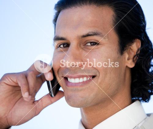 Portrait of a smiling business man using a cellphone