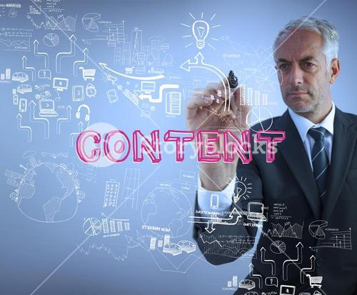 Businessman holding a marker and writing the word content