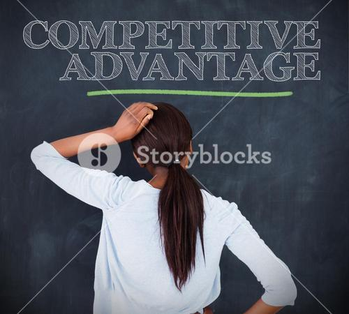 Woman looking at the word competitive advantage