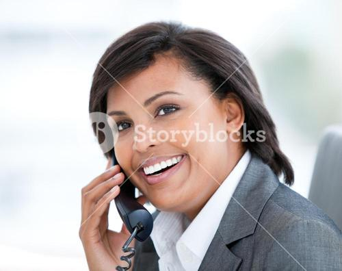 Portrait of a radiant business woman talking on phone