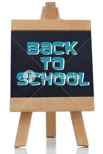 Back to school written in blue on chalkboard