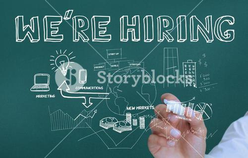 Hand holding a marker and writing we are hiring