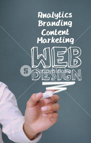 Businessman writing web design with a marker