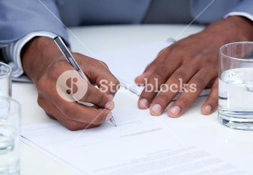 Close up of ambitious business man signing a contract