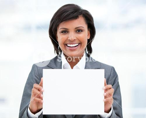 Smiling businesswoman holding a white card