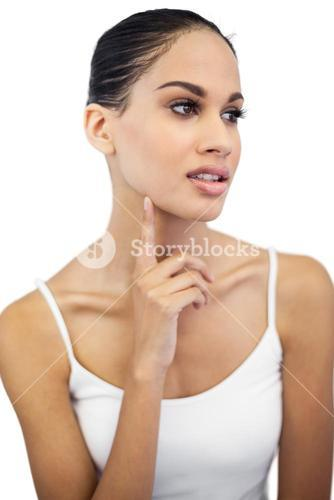 Beautiful woman with finger on her face looking away
