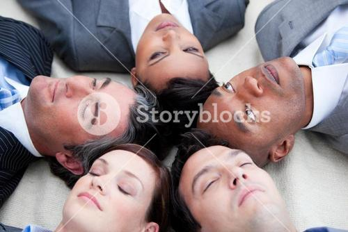 Close up of relaxed business team lying in circle